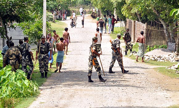 Army men patrol a violence-hit area in a district in Assam