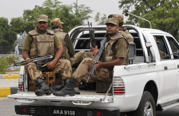 Pakistan army soldiers patrol near the Minhas base in the town of Kamra, Pakistan
