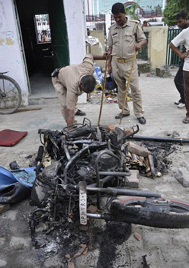Charred remains of a motorbike set on fire by the mob