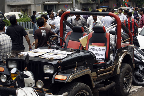 A jeep carrying placards condemning the violence in Mumbai