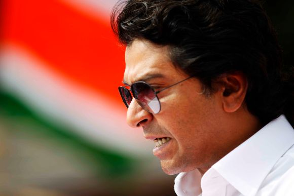 MNS chief Raj Thackeray reacts while addressing a mammoth rally at Mumbai's Azad Maidan on Tuesday
