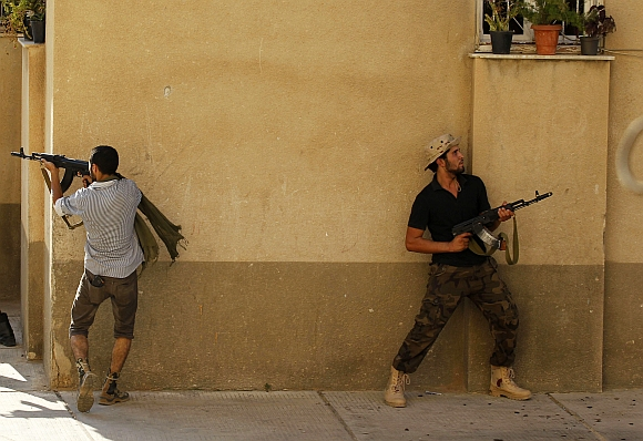 Libyan rebel fighters during the final push to flush out Muammar Gaddafi's forces in Abu Salim district in Tripoli on August 25, 2011