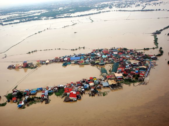 Houses swamped by floodwaters in Bulacan province, north of Manila, Philippine seen in this aerial photograph released by the department of national defence on August 8, 2012