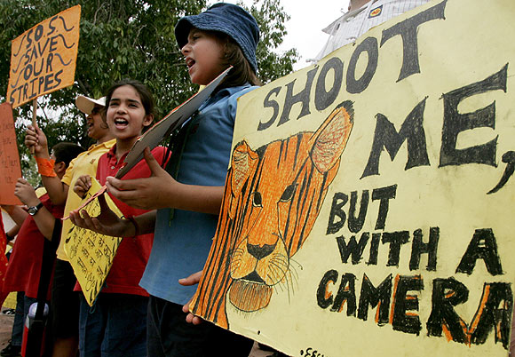 Children shout slogans as they take part in a campaign to save tigers from poaching in New Delhi