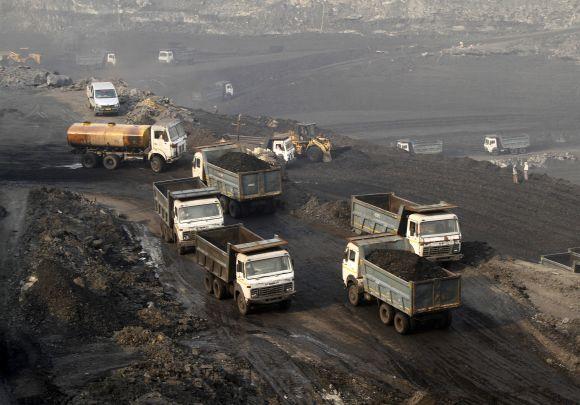Trucks move in the Mahanadi coal fields in Odisha