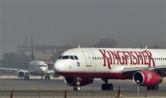 Kingfisher pilot flies woman in cockpit, probe on