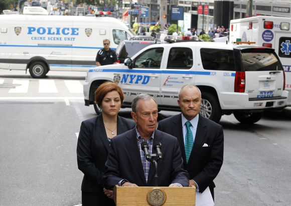 New York City Mayor Michael Bloomberg speaks to the press with New York Police Commissioner Ray Kelly and Speaker Quinn at the scene of shooting