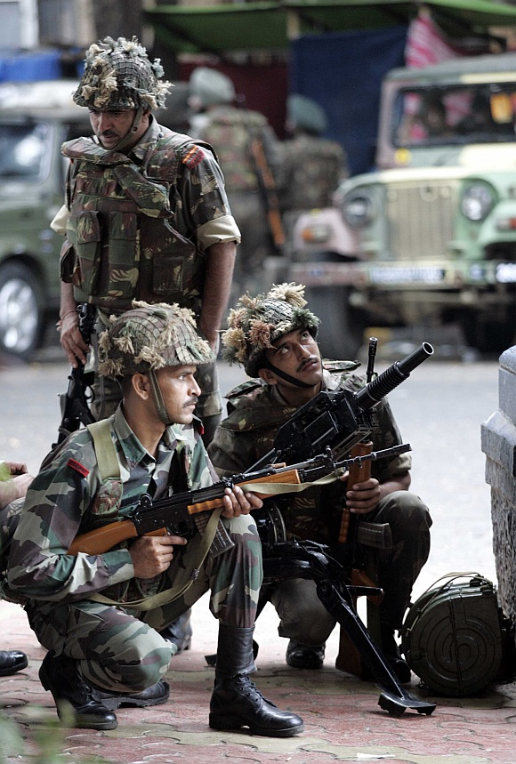 Soldiers take positions outside Taj Mahal Hotel during a gun battle in Mumbai on November 29, 2008