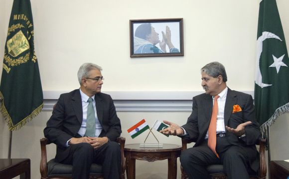 Pakistan's Defence Minister Naveed Qamar (R) talks with Defence Secretary Shashikant Sharma at the Defence Ministry in Rawalpindi, near Islamabad on June 11.