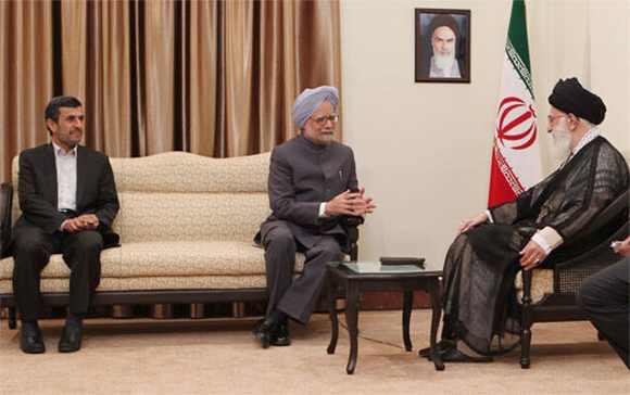 PM chats with Khamenei as Iran President Ahmadinejad looks on