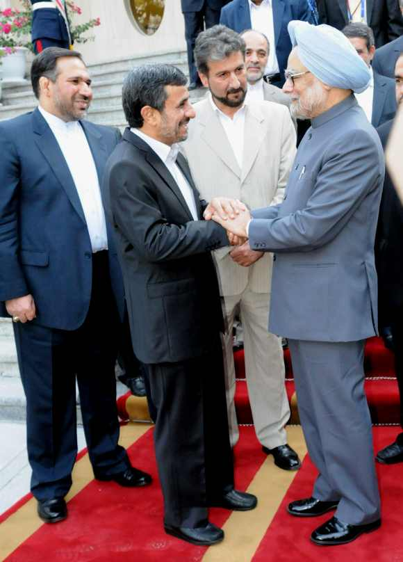 Iran President Ahmadinejad interacts with Dr Singh