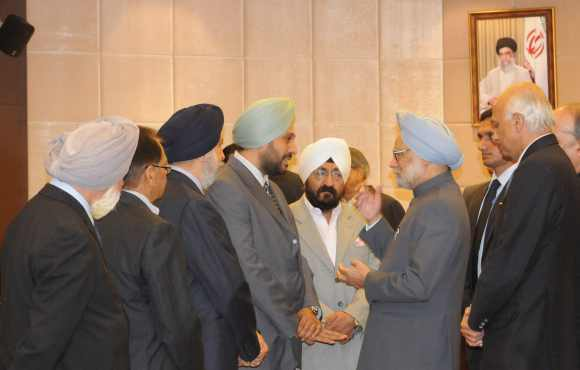 Dr Singh interacts with representatives of the Indian community on the sidelines of the NAM summit