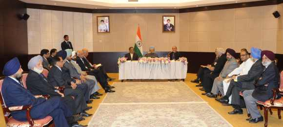 PM, External Affairs Minister S M Krishna and India envoy to Iran D P Srivastava interact with the Indian community in Tehran