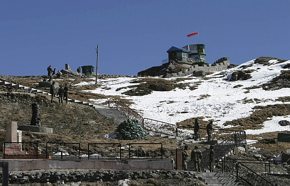 Indian army soldiers are seen after a snowfall at the India-China trade route at Nathu-La, 55 km north of Gangtok, Sikkim