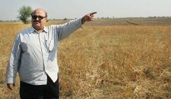 Ashrafbhai Pathan points towards the cast stretches of land he recently sold to GIDC