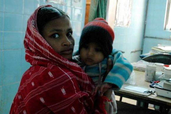 A mother is seen with her child at the Malda Hospital