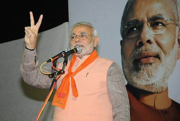 Narendra Modi addresses his supporters at Maninagar constituency