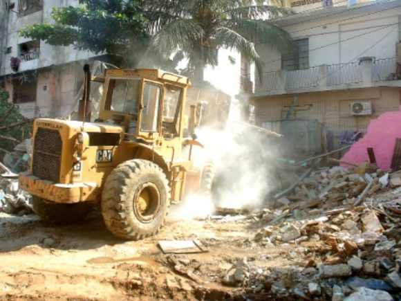 A bulldozer razes the temple in Karachi
