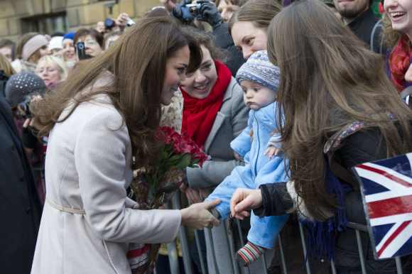 Catherine, Duchess of Cambridge meets 5 month-old James William Davies, who was named after Prince William in Cambridge