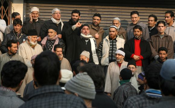 Members of Shia and Sunni communities hold a peace march to ease tension in curfew-bound parts of Srinagar on Tuesday