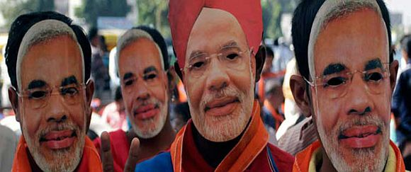 Modi's supporters wear masks depicting their leader