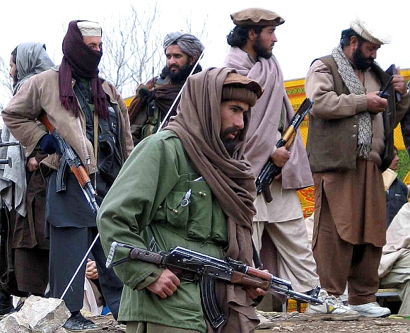 Armed tribesmen stand guard during a traditional tribal assembly in Sararogoha, about 80 km northeast of Wana, the main town of the South Waziristan tribal region