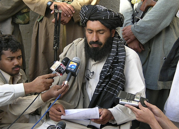 Mullah Nazir of the Wazir tribe reads his statement during a news conference in Wana