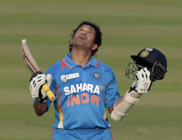 Sachin Tendulkar celebrates after scoring 100th international centuries during Asia Cup match against Bangladesh in Dhaka