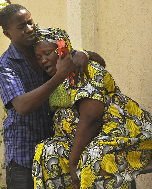 Relatives of victims of a gun attack mourn at the Aminu Kano Teaching Hospital in Nigeria's northern city of Kano April 29, 2012