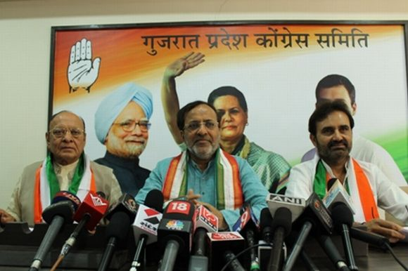 Gujarat Congress chief Arjun Modhwadia, senior leader Shankarsinh Vaghela and Gujarat Leader of Opposition Shaktisinh Gohil address mediapersons in Ahmedabad