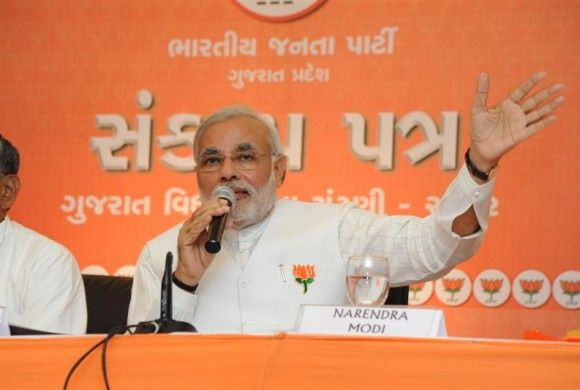 Narendra Modi speaks after unveiling the BJP's election manifesto in Ahmedabad