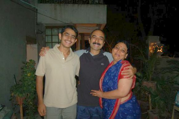 Shweta Bhatt with her husband Sanjiv and son at their residence in Ahmedabad