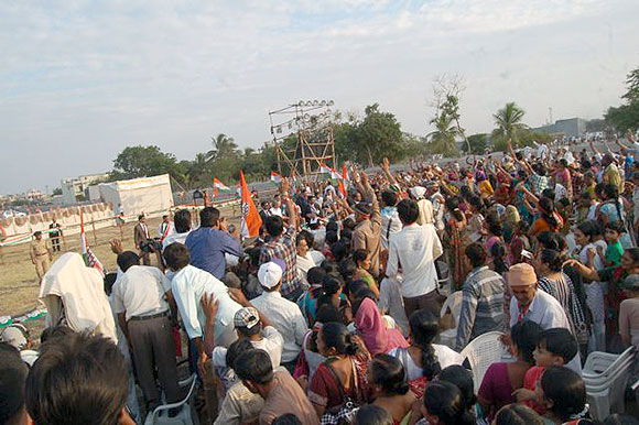 Supporters cheer during Sonia Gandhi's rally in Keshod