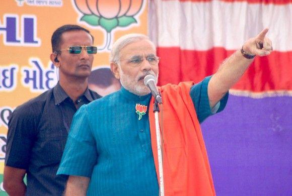 Narendra Modi addressing a rally in Gujarat's Narmada district