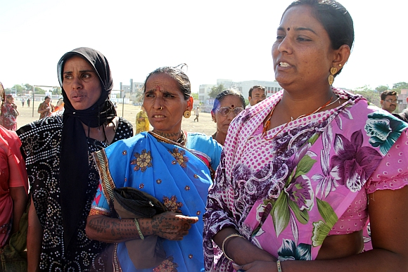 Dahiben (in blue saree), an Amreli resident