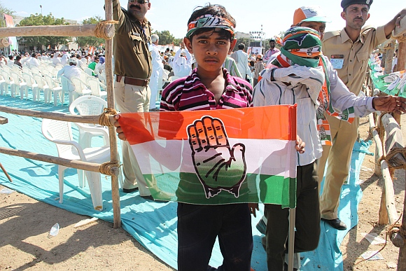 A boy holds the Congress flag at the rally