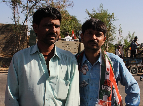 Mukesh Chotangia (left), a tailor from Aneeda village
