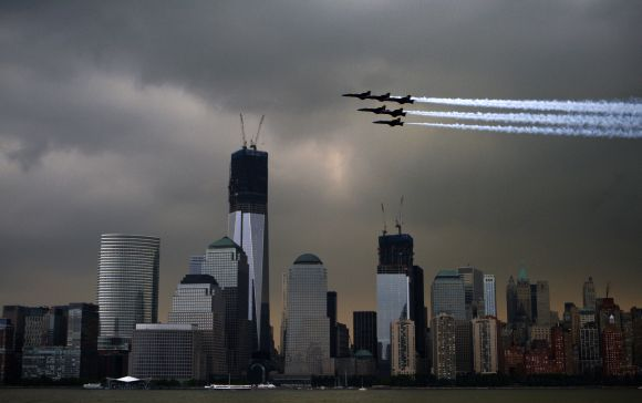 Members of the U.S. Navy Blue Angels fly over the World Trade Center as part of Fleet Week celebrations in New York