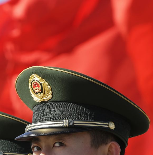 A Chinese paramilitary police official keeps watch on Beijing's Tiananmen Square