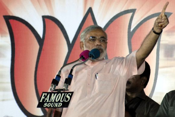 Gujarat's Chief Minister Narendra Modi addresses an election campaign rally
