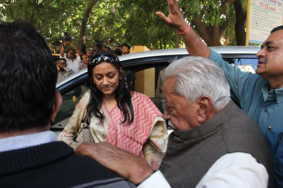 Former CM and GPP chief Keshubhai Patel arrives at a polling booth in Rajkot on Thursday morning