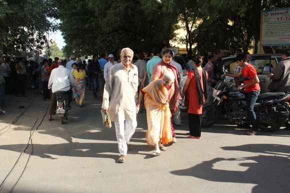 Voters entering a polling booth in Rajkot on Thursday