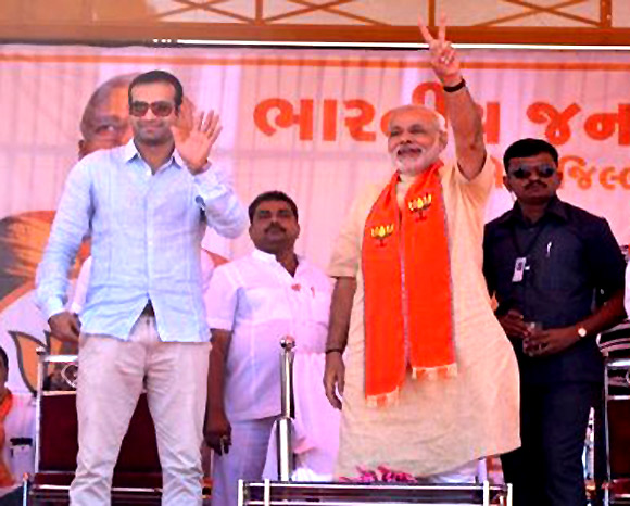 Irfan Pathan campaigns with Narendra Modi.