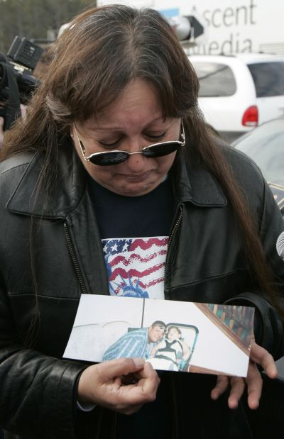 A woman cries for her brother who was killed in the 2005 Red Lake High School massacre in Minnesota.