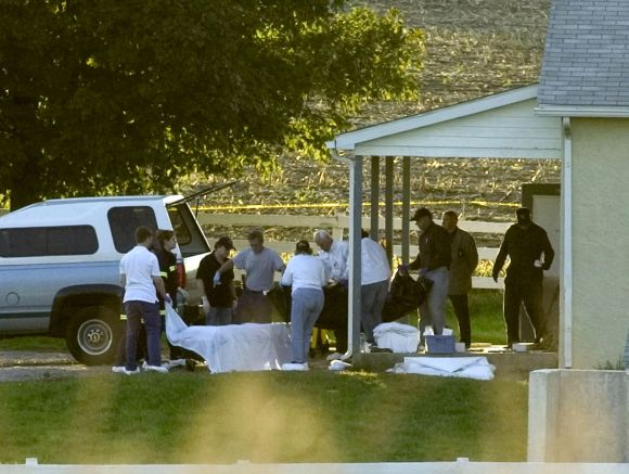 The body of the gunman is carried from a schoolhouse in Nickel Mines, Pennsylvania, October 2, 2006