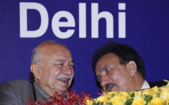 Home Minister Sushilkumar Shinde speaks to his Pakistani counterpart Rehman Malik during a meeting in New Delhi on Friday