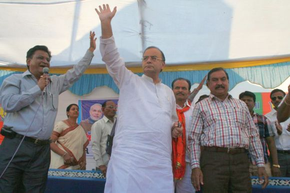 Jaitley arrives at a campaign rally in Kapadvanj, Gujarat