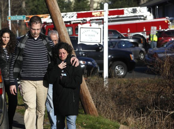 Families leave the Sandy Hook Volunteer Fire Department near the Sandy Hook Elementary School in Newtown, Connecticut,