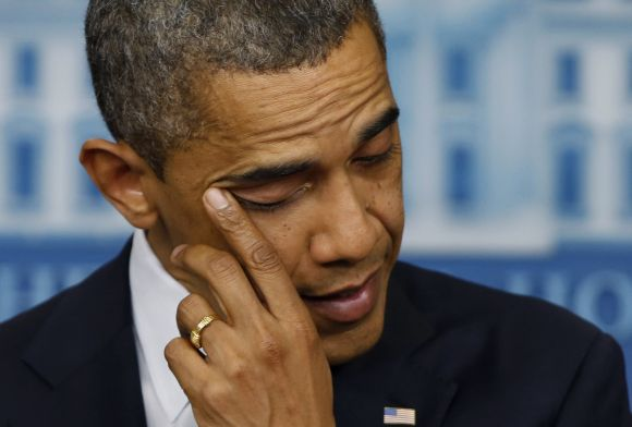 U.S. President Barack Obama wipes a tear as he speaks about the shooting at Sandy Hook Elementary School in Newtown, Connecticut