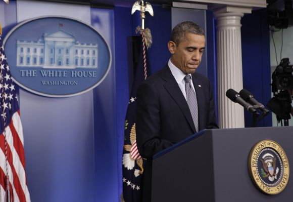 U.S. President Barack Obama pauses as he makes a statement about the shooting at Sandy Hook Elementary School in Newtown, Connecticut